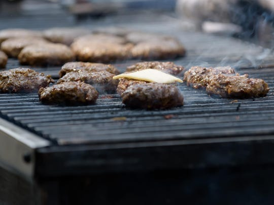 Burgers over the coals Saturday at the Delaware Burger Battle, where restaurants put their best burgers forward for judgment. Money goes to the Ministry of Caring.