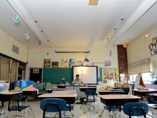 Teacher Stacy Buckner prepares her classroom Sept. 2 at the Lansing School District's Sheridan Road Elementary.