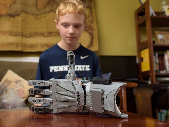 Colin Consavage's prosthetic hand took about 12 hours to print, with each finger done separately and jointed together later.