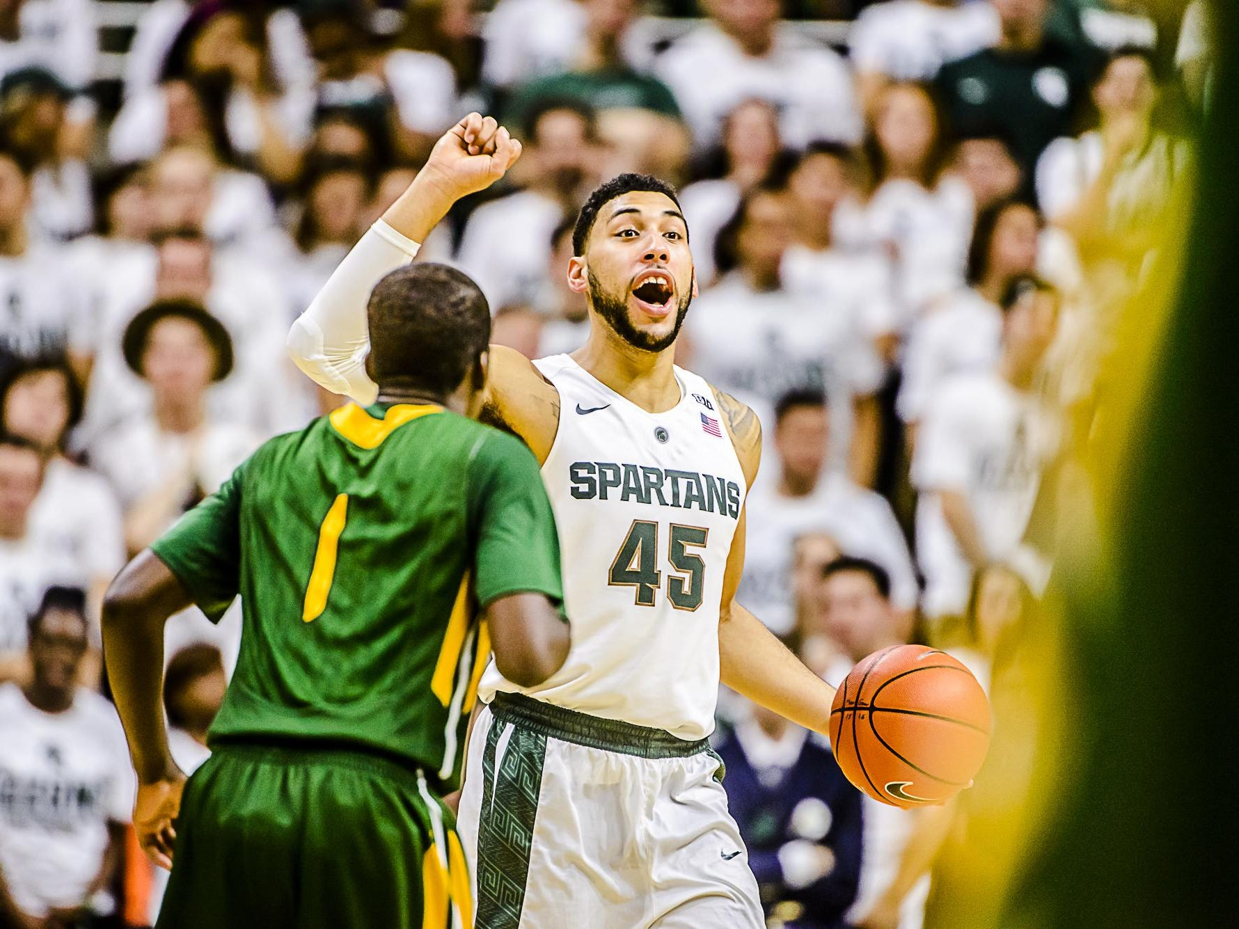 Denzel Valentine, here running the point last week in an exhibition against Northern Michigan, is on pace to finish near the top 10 at MSU in scoring and rebounding and top five in assists and 3-pointers made.