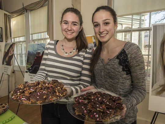 Cookie bakers Hannah Ververs, 15 of Mount Tabor and Nora Rigolosi, 15, of Parsippany, with their Summer's Salted Toffee.