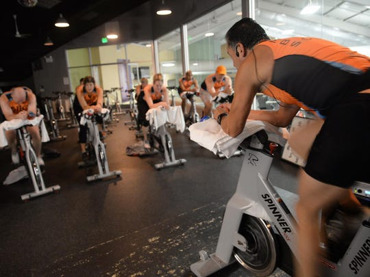 Raul Sosa leads the team through a spin class at Beverly Hills Club.