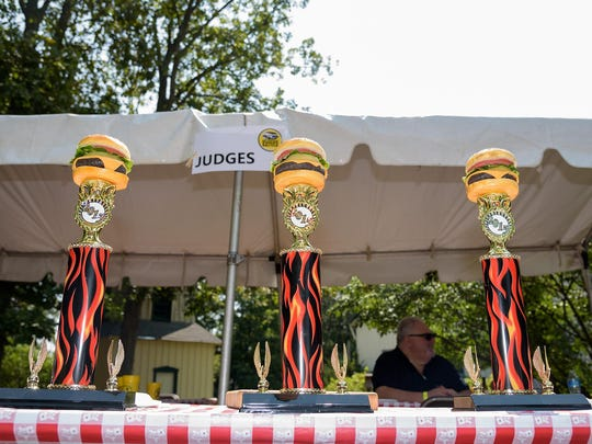 Trophies are awarded to the best tasting burgers at The Delaware Burger Battle, which takes place at noon Saturday.