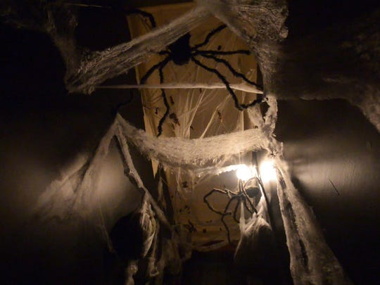 Spider webs hang from the ceiling at House of Horrors in Bells, Tenn.