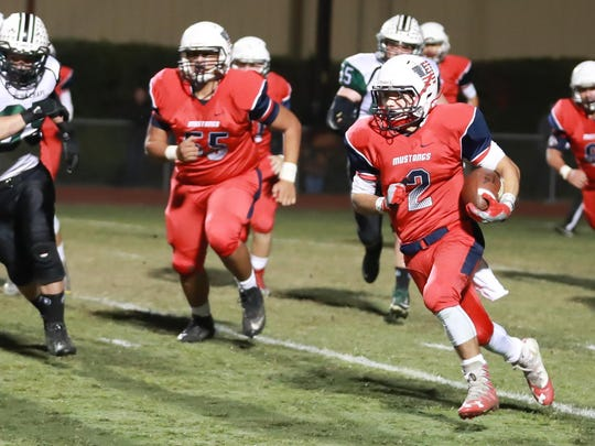 Tulare Western running back David Alcantar turns the corner in a Central Section Division III quarterfinal game.