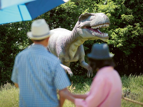 """Visitors enjoying """"Field Station: Dinosaurs"""" at its temporary home in the Leonia section of Overpeck Park. Another section of the park, in Teaneck, will be the permanent home."""