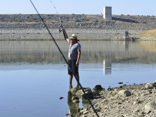 Ruben Ibarra fishes at Richard L. Schafer Dam, formerly known as Success Dam.