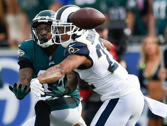FILE - In this Dec. 10, 2017, file photo ,Los Angeles Rams cornerback Trumaine Johnson, right, defends a pass intended for Philadelphia Eagles wide receiver Alshon Jeffery during the first half of an NFL football game in Los Angeles. The New York Jets have signed former Rams cornerback Trumaine Johnson to a five-year, $72.5 million contract. (AP Photo/Kelvin Kuo, File)