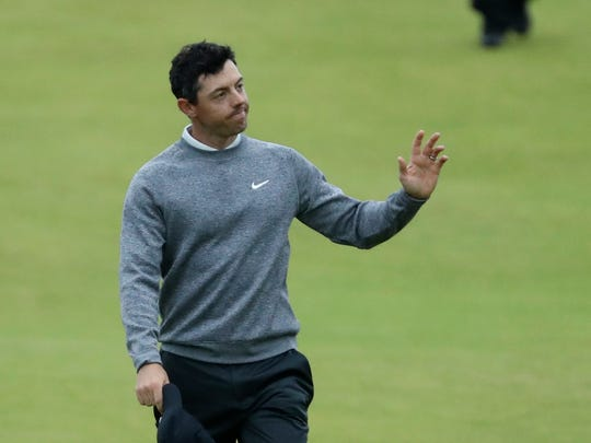 Northern Ireland's Rory McIlroy waves to the crowd as he walks onto the 18th green during the second round of the British Open Golf Championships at Royal Portrush in Northern Ireland, Friday, July 19, 2019.(AP Photo/Peter Morrison)