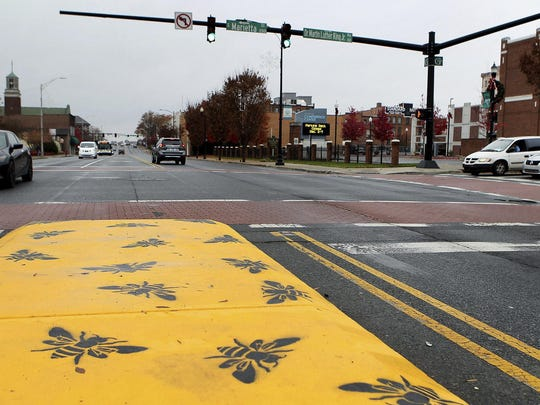 The concrete median on Franklin Boulevard in Gastonia, N.C., was recently painted to celebrate the community becoming a Bee City USA and to remind residents to protect pollinators.