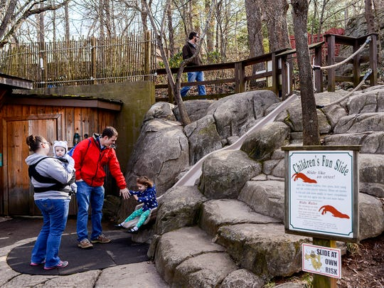 Families check out the exhibits at the WNC Nature Center on New Year's Eve. The center helped pioneer the concept of zoos focused on only native species.