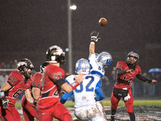 Bucyrus Quarterback Cole Murtiff throws the ball only to be intercepted by Wynford's Hayden Rhoades, 32.