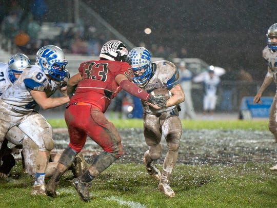Wynford's Nick Looker runs the ball Friday night against Bucyrus. The Royals beat the Redmen 30-0.