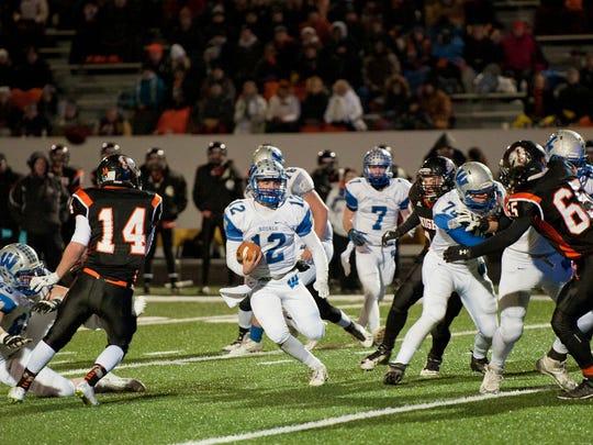 Wynford quarterback, Keaton Teynor, runs the ball.