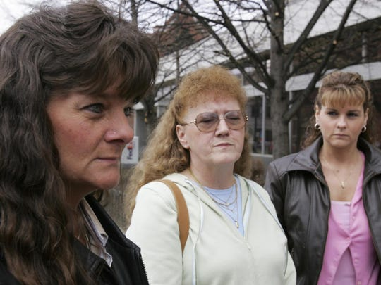 Terry King's daughters, Lori Hibbard, left, and Karen Worcester, right, and sister Barbara Tuttle, center, talk with reporters before entering federal court in May 2005 in Burlington to watch jury selection for the trial of Donald Fell.
