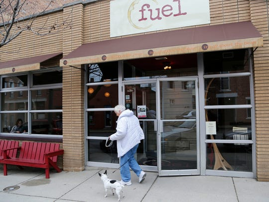 A patron leaves fuel coffee Wednesday, March 25, 2015, in downtown Lafayette. The popular coffee shop is moving from its current location at 1016 Main Street across the street and into the space of the former Main Street Wine & Cheese.