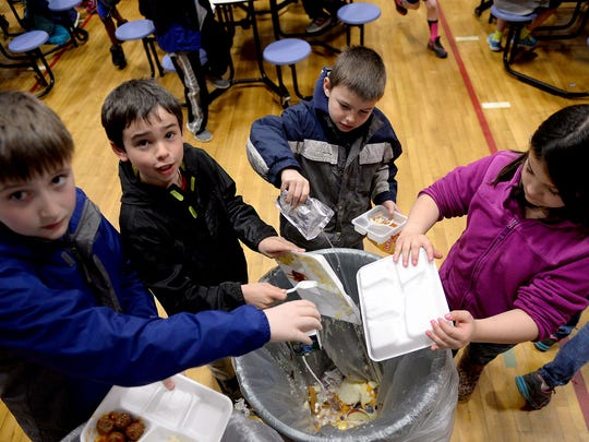 Students at Horizon Elementary discard their uneaten food into a special trash can Thursday. The food waste is collected in a trash can and is sent to the Delhi Township wastewater treatment plant where it is ground up and fed to an anaerobic digester.
