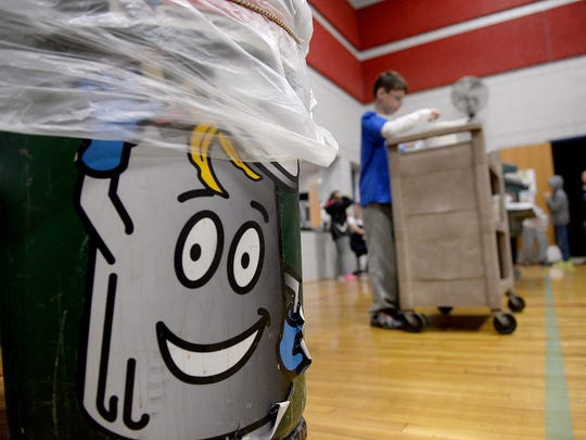 A cartoon character, Scrappy, encourages Horizon Elementary School students to recycle their food.