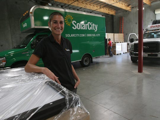 SolarCity regional operations manager Oceana Lamberto-Egan offers a tour of the company's warehouse and facility in Thousand Palms on Nov. 25, 2013.