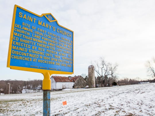 A historic marker sign sits outside the Coffee Run Cemetery. The Trinity Community Church purchased the property and will soon file preliminary plans to build.