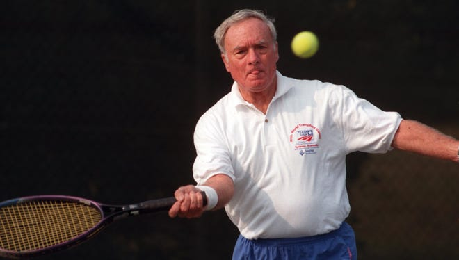 Even into his later years, Roger MacDonald stayed active as a competitive tennis player. He is shown in this 2004 photo competing in a tournament. MacDonald, 84, died last weekend and leaves a legacy as a Navy veteran who retired in Pensacola and became a loyal supporter of UWF athletics, the Blue Wahoos and other local sports.