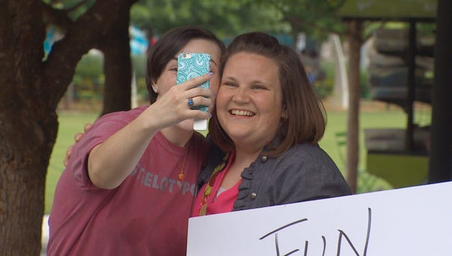 Candace Payne, right, has made the television show rounds after her Facebook Live video of her trying on a Chewbacca mask dominated social media.