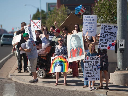 St. George residents march Bluff Street in solidarity