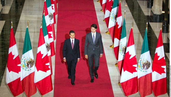 Mexican President Enrique Peña Nieto (left) and Canada's prime minister Justin Trudeau say making it easier for Mexicans to travel to Canada show new relationship between the two countries.