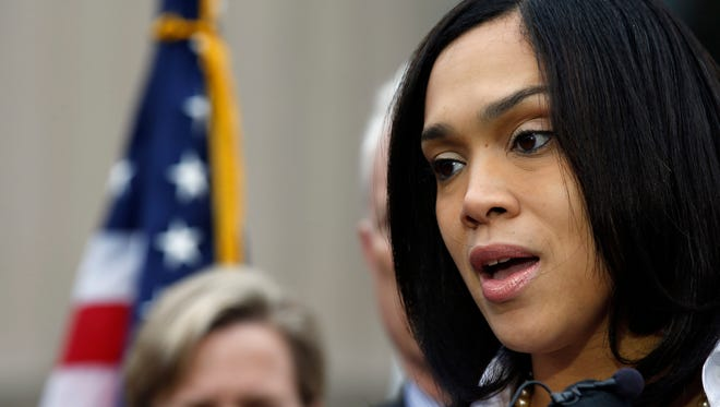 Marilyn Mosby, Baltimore state's attorney, addresses a news conference on May 1 in Baltimore. Mosby announced criminal charges against all six officers suspended after Freddie Gray suffered a fatal spinal injury while in police custody.