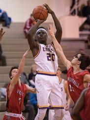 PCA's Max Okolo (20)shoots for the basket, guarded