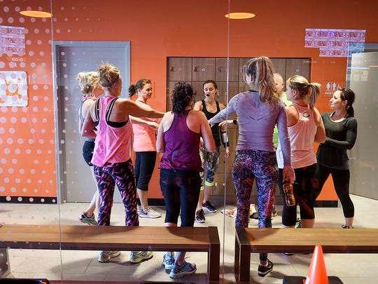 "Clients rally before the start of their hour-long workout at Orangetheory Fitness Tuesday, Jan. 3, in Waite Park. Classes are structured to keep clients heart rates in the ""orange zone"" through heart-rate monitored workouts."
