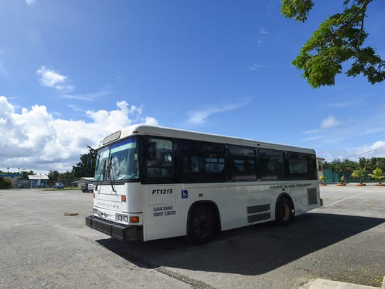 A Guam Mass Transit Authority bus departs the Guam