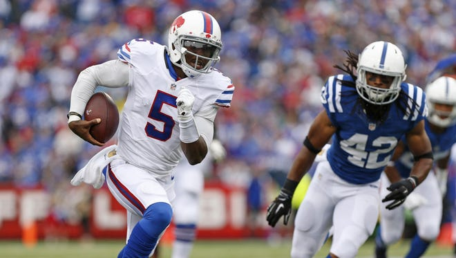 In this file photo, Buffalo Bills quarterback Tyrod Taylor (5) runs with the ball as Indianapolis Colts strong safety Clayton Geathers (42) pursues.