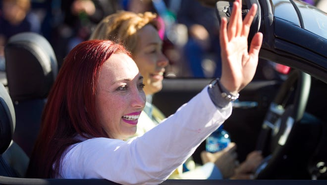 Amy Van Dyken-Rouen serves as the grand marshal of the Fiesta Bowl Parade on Saturday.