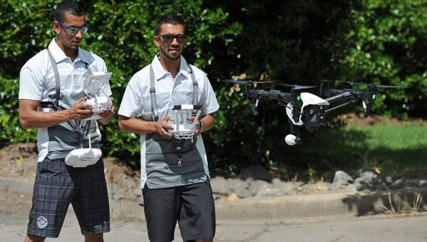 Pro Bros Productions' Sergio, left, and Carlos Loaiza fly a drone outside the company's office in Greenville, S.C., Tuesday, June 2, 2015.