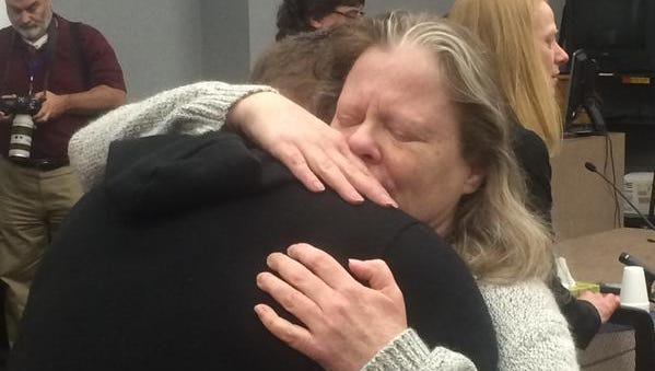 Theresa Supino hugs her son, Rocky Supino, after she was found not guilty in the 1983 deaths of her husband, Steven Fisher, 20, and his 17-year-old girlfriend, Melisa Gregory.