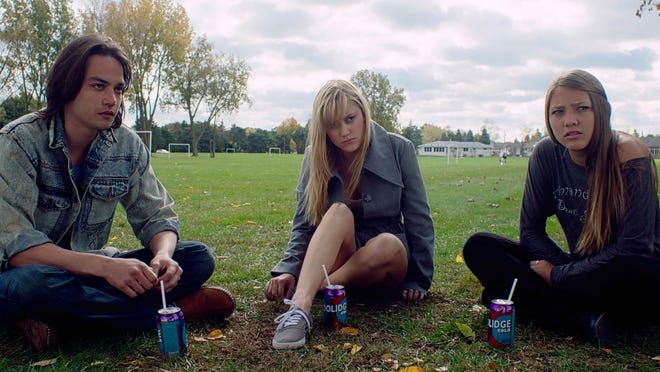 """Daniel Zovatto (left), Maika Monroe and Lili Sepe star in """"It Follows"""" about a supernatural force that only victims see."""