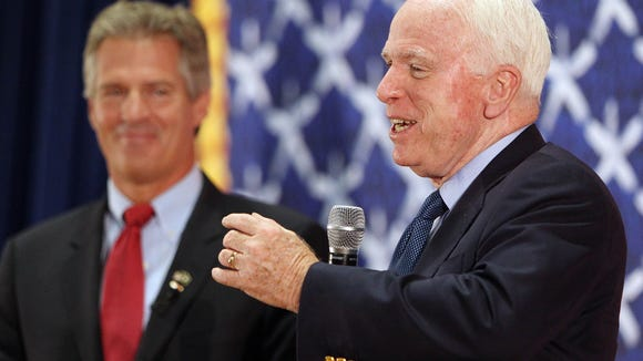 Sen. John McCain, R-Ariz., right, is standing by his