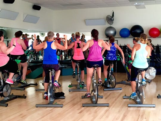 A group fitness class, such as RPM at the Greenheck Field House, is one way to burn calories.