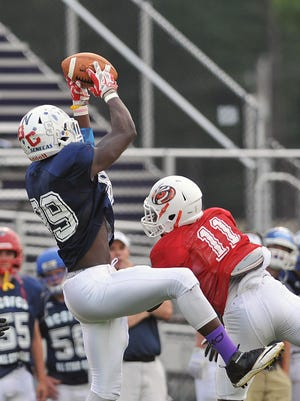 The North's Tyrell Edmiston comes down with a catch during the Saturday's All-Star game.
