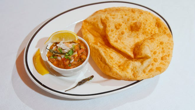 The popular Punjab dish, chole bhatura is a spicy curry (chile) made with chick peas and is paired with bhatura, a fried leavened bread. The dish is often accompanied by lemons and green chilis.30 March 2017