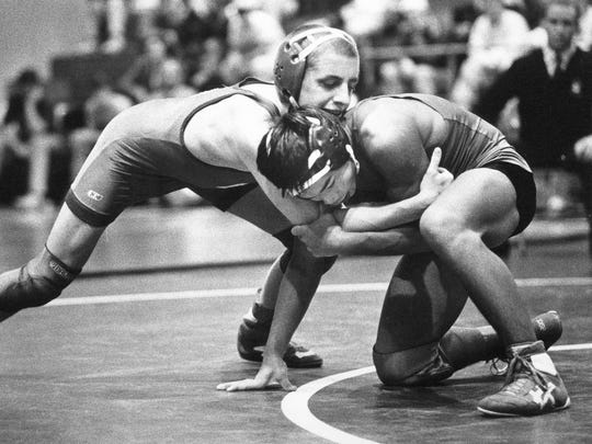 DECEMBER 22, 1991: Fairfield's Willie Wineberg (top) maneuvers for position with Lakota's Thik Phou during their match in the Coaches Classic Saturday. Wineberg won the 112-pound title to lead Fairfield to the team championship. The Enquirer/Tony Jones Scanned 1/10/2018