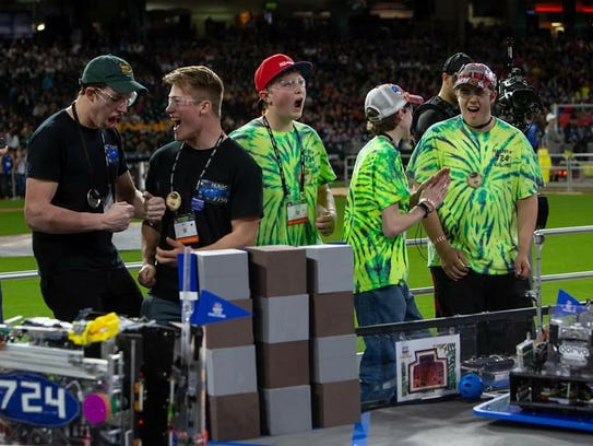 Holter Sand, Luke Ostberg and Winston Fee of the RedNek Robotics team (in neon) battled their way to a world championship.