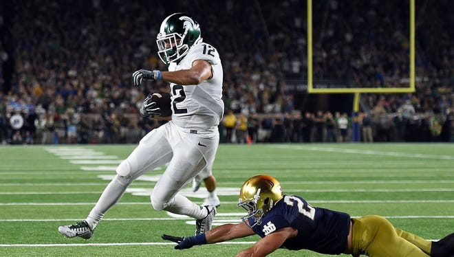 Michigan State wide receiver R.J. Shelton scores a touchdown in front of Notre Dame's Drue Tranquill during the first half of MSU's 36-28 win Saturday in South Bend, Ind.