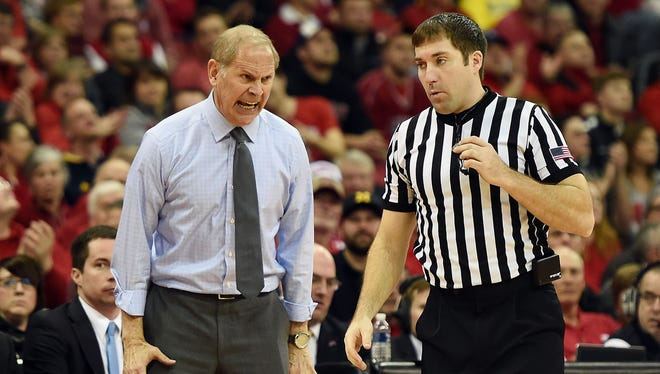 Michigan coach John Beilein reacts to an official's call during U-M's 68-64 loss to Wisconsin Tuesday in Madison, Wis.