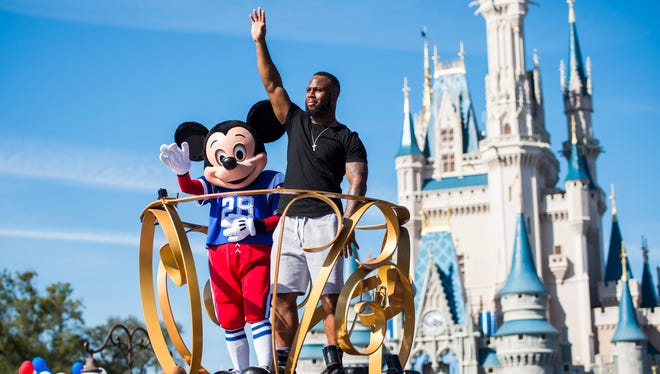 The company behind Mickey Mouse, shown here with running back James White of the New England Patriots on Feb. 6, 2017, at Walt Disney World in Buena Vista, Fla., increased security before the Oct. 1, 2017, Las Vegas shootings but likely will look for additional ways to ensure tourists' safety, security experts say.