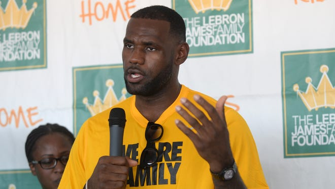 """LeBron James speaks with reporters following the LeBron James Family Foundation """"I Promise"""" reunion event Thursday, Aug, 13, 2015."""