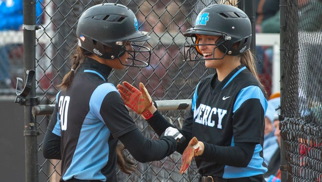 Mercy's Kayla Bauer, right, congratulates Mercy designated player Jinhee Walsh after Walsh scores.