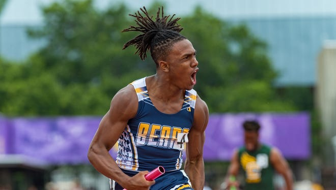 Trejun Jones wins the 4 x 200 relay at the LHSAA State Track Meet at LSU's Bernie Moore Track Stadium. Saturday, May 5, 2018.