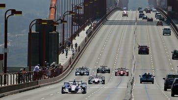 IndyCar driver Marco Andretti, driving Justin Wilson's No. 25 car, leads a motorcade in honor of Wilson over the Golden Gate Bridge, Thursday, Aug. 27, 2015, in Sausalito, Calif. Wilson, of England, died Aug. 24 from injuries sustained at Pocono Raceway.